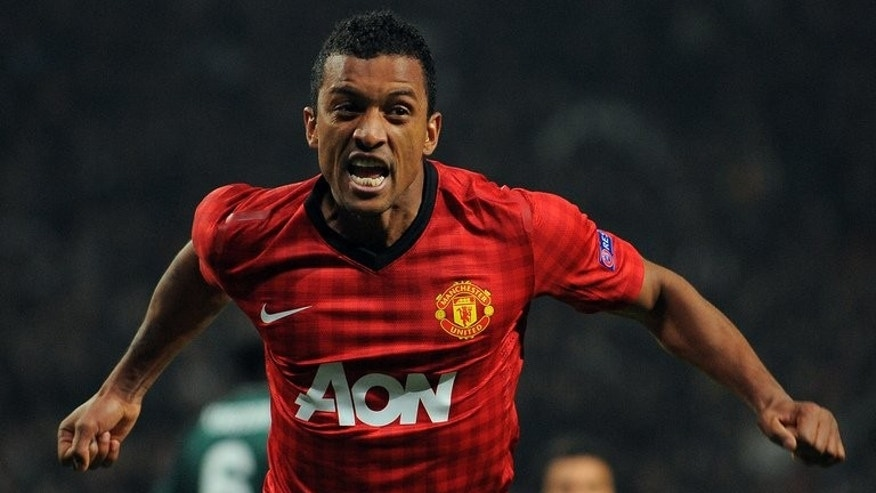 Manchester United's Portuguese midfielder Nani celebrates during a match against Real Madrid at Old Trafford in Manchester on March 5, 2013. Nani has signed a new five-year contract at Manchester United, the Premier League champions announced.