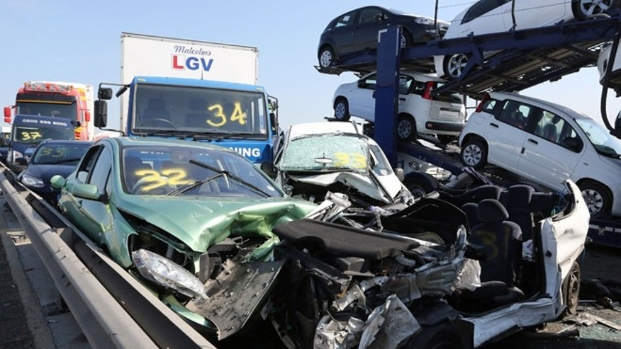 "Sept. 5, 2013: A view showing just a few of the vehicles involved in a major accident on the Sheppey Bridge Crossing near Sheerness in Kent, south England, following a multi vehicle collision earlier this morning. The vehicles involved are numbered by emergency services. According to police at the scene around 100-vehicles are involved in the pile-up on a bridge in heavy fog, leaving at least eight people seriously injured and many with minor injuries after what witnesses described as ""carnage."""