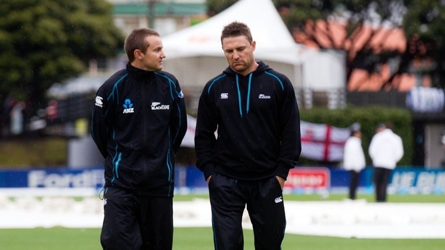 New Zealand's head coach Mike Hesson (L), seen here with team captain Brendon McCullum, at the Basin Reserve in Wellington, on March 18, 2013. New Zealand named two uncapped players on Friday in a 15-man Test squad for their upcoming Bangladesh tour but will be missing injured veterans Daniel Vettori and Martin Guptill.