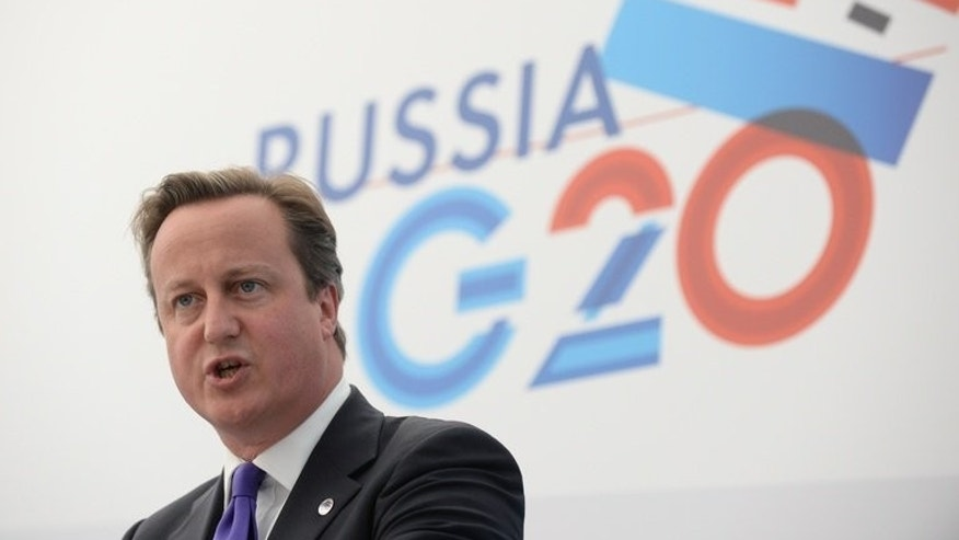 "David Cameron gives a press conference at the G20 summit on September 6, 2013 in Saint Petersburg. The Prime Minister strongly defended Britain's achievements after a Russian official reportedly dismissed it as a ""small island"" with no international influence."