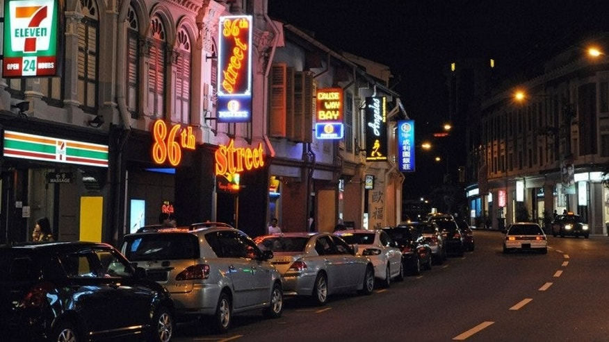 A row of pubs and bars along Tanjong Pagar in Singapore. Prostitution is legal but pimping and public solicitation are not in the island-state. Five Chinese nationals have been charged following Singapore's latest crackdown on underage prostitution.