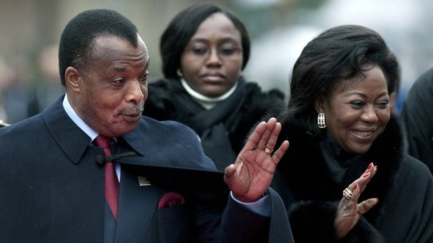 Republic of Congo President Denis Sassou Nguesso and his wife, Antoinette, arrive at a ceremony on October 23, 2010 in Montreux. Congo's president has made an impression on a small town in recession-hit Spain -- after relaxing at its thermal baths for a few days he left local residents 10,000 euros ($13,000).