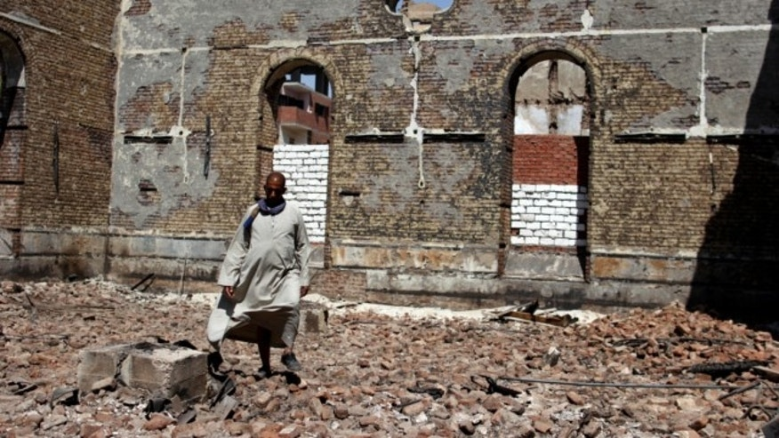 Sept. 3, 2013: A guard walks in the damaged Evangelical Church of Malawi that was looted and burned by Islamists, in Malawi, Minya province, Egypt.