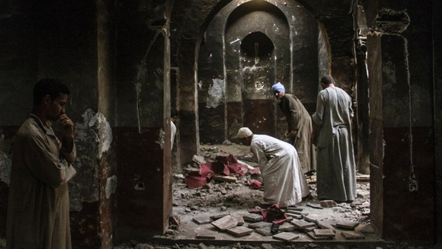 Sept. 3, 2013: In this photo, Egyptian Christian villagers clean up the damaged ancient chapel inside the Virgin Mary and St. Abraam Monastery that was looted and burned by Islamists, in Dalga, Minya province, Egypt. Dalga has been outside government control since hard-line supporters of the Islamist Mohammed Morsi drove out police and occupied their station on July 3, the day Egypts military chief removed the president in a popularly supported coup. It was part of a wave of attacks in the southern Minya province that targeted Christians, their homes and businesses.