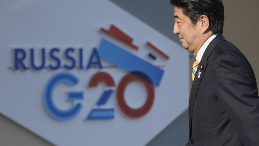 Japan???s Prime Minister Shinzo Abe arrives for the start of the G20 summit in Saint Petersburg, Russia, on September 5, 2013. Abe urged a reset in frayed ties with China at his first face-to-face meeting with Chinese President Xi Jingping. The meeting took place on the sidelines of the summit.