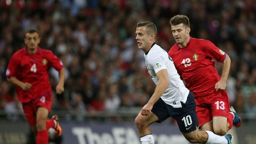 England's Jack Wilshere (2nd R) runs with the ball against Moldova during a World Cup 2014 qualifying football match between England and Moldova in London, on September 6, 2013.