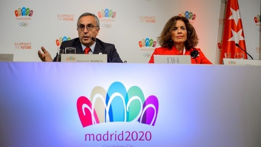Spanish Olympic Committee President Alejandro Blanco (L) gestures next to Madrid's Mayor Ana Botella during a press conference to promote Madrid for 2020 Olympic games on September 6, 2013 in Buenos Aires. Madrid can deliver a welcome dose of good news to Spain by winning the right to host the 2020 Summer Olympics when the International Olympic Committee members vote in Buenos Aires on Saturday