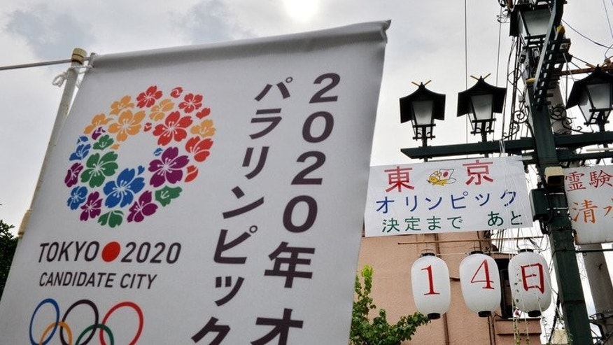 A countdown board promoting Tokyo's bid for the 2020 Summer Olympics hangs in downtown Tokyo, August 24, 2013. International Olympic Committee (IOC) members vote in Buenos Aires on Saturday on which city will win the right to host the games