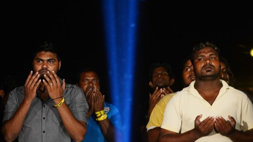 Followers of Presidential candidate Mohamed Nasheed pray during a political rally in Male, the capital of Maldives on September 5, 2013.