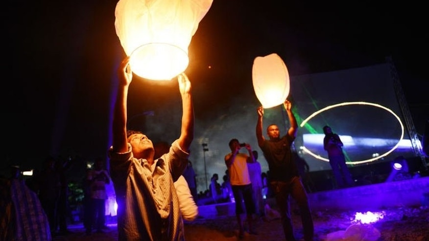 Followers of Presidential candidate Mohamed Nasheed release hot air balloons during a political rally in Male, the capital of Maldives on September 5, 2013.