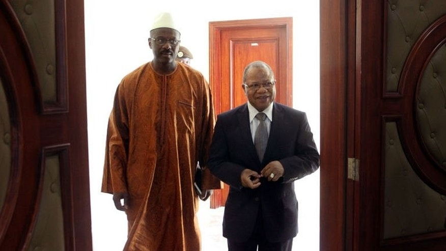 Former Malian Prime minister Django Sissoko (R) hands over to his successor Oumar Tatam (L), on September 6, 2013 in Bamako. Mali's first post-war prime minister has begun the task of forming a government expected to deliver on promises by the president to reunite a deeply divided nation and crack down on corruption.