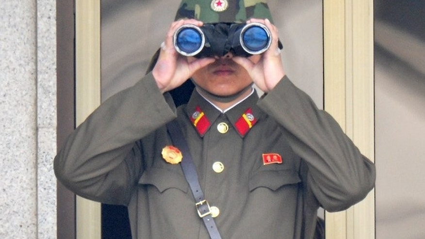 A North Korean soldier is seen at the truce village of Panmunjom in the demilitarised zone, on April 23, 2013. North Korea on Friday reconnected a military hotline to the South that was cut earlier this year at the height of cross-border tensions, Seoul's government said.