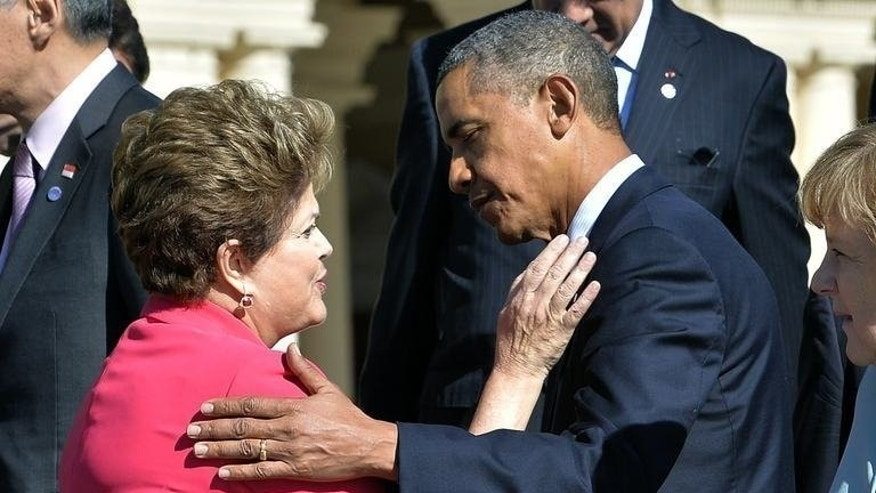 US President Barack Obama greets Brazil???s President Dilma Rousseff at the G20 summit on September 6, 2013 in Saint Petersburg. Obama moved to defuse a row with Brazil and Mexico over alleged US spying on leaders of the Latin American countries.
