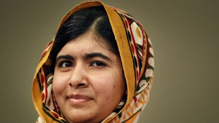 Pakistani activist Malala Yousafzai poses for a photograph after being awarded the International Children's Peace Prize at The Hague, on September 6, 2013.