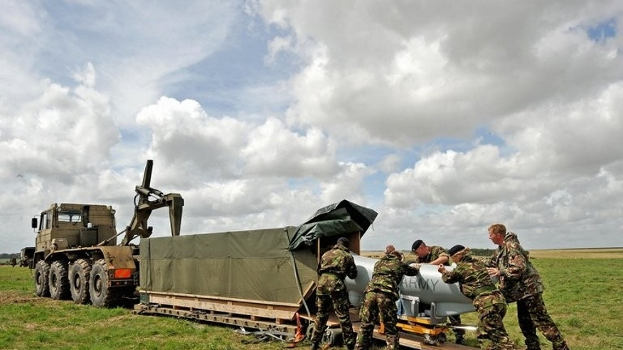 British soldiers load an unmanned aerial vehicle at Westdown Camp near Salisbury on July 22, 2009.