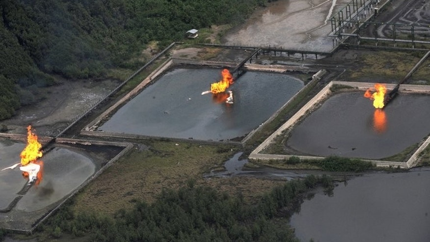 Gas flares at Shell Cawtharine Channel, Nembe Creek in the Niger Delta, seen on March 22, 2013. Shell says it is to begin compensation talks with thousands of Nigerian villagers who say their livelihoods were ruined by two massive oil spills in the Niger Delta.