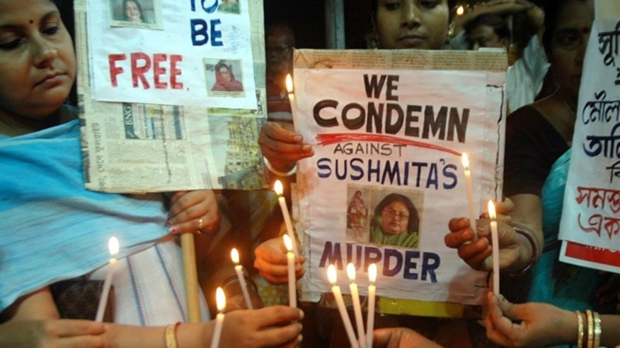 Sept. 6: Indian women participate in a candlelight vigil condemning the killing of Indian author Sushmita Banerjee in eastern Paktika province.