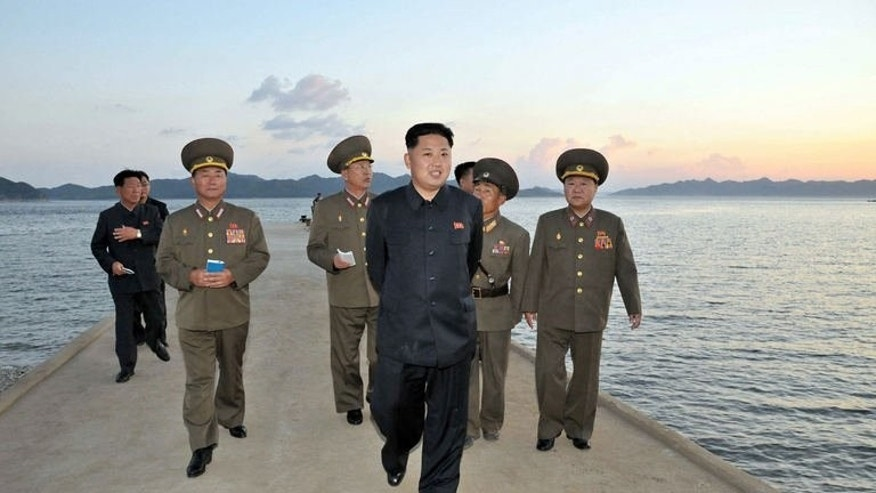This picture released from the Korean Central News Agency (KCNA) on September 4, 2013 shows North Korean leader Kim Jong-Un (C) in South Hwanghae province.