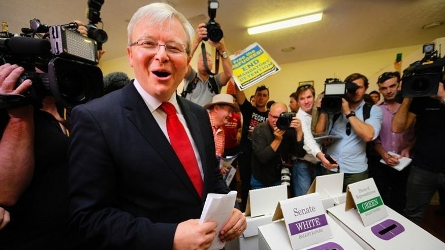 Australian Prime Minister Kevin Rudd votes at St Paul's Anglican Church, Brisbane on September 7, 2013. Rudd has struggled for traction after toppling Julia Gillard as Labor leader just weeks before calling the election and his party seems destined for a period in opposition.