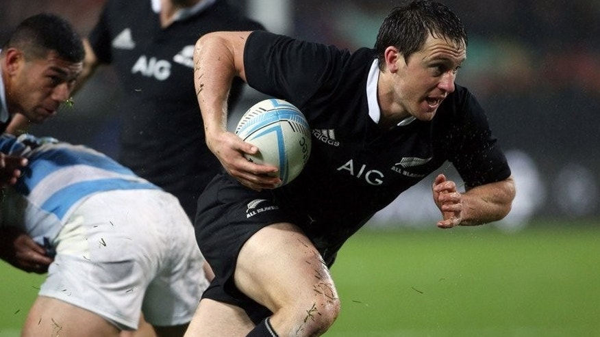 Ben Smith of New Zealand runs the ball forward during a match on September 7, 2013. The team said they had no intention of toning down their high-risk running game when they clash with South Africa next week.