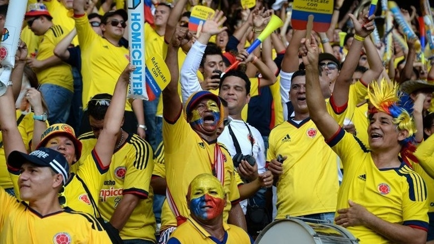 Colombian supporters cheer for their team before the start of the FIFA World Cup Brazil 2014 qualifying match against Ecuador at the in Barranquilla on September 6, 2013. An alleged drug don, Claudio Baez, was arrested in Colombia as he headed to the football match, police said Saturday.