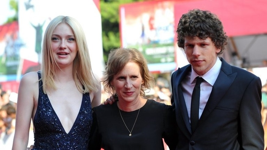 "US director Kelly Reichardt (C), actor Jesse Eisenberg and actress Dakota Fanning arrive for the screening of ""Night Moves"" presented in competition at the 70th Venice Film Festival on August 31, 2013 at Venice Lido. Reichardt's hushed but thrilling ""Night Moves"" is one of the favourites to win Venice's Golden Lion prize"