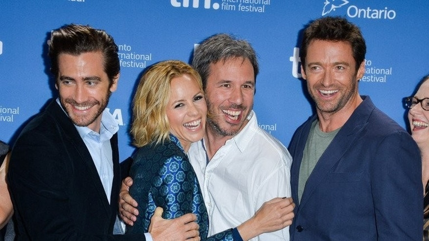 L-R: Actor Jake Gyllenhaal, Actress Maria Bello, Director Denis Villeneuve and Actor Hugh Jackman during the 2013 Toronto International Film Festival on September 6, 2013 in Toronto. Quebec filmmaker Villeneuve unveiled a new kind of thriller at the Toronto film festival Saturday, a layered morality tale that explores every parent's worst fear -- a child's abduction.