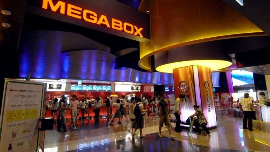 Movie-goers visit a Megabox cinema in Seoul on July 19, 2007. The cinema chain, under pressure from conservatives on Saturday, withdrew a controversial documentary film challenging government findings that a warship sunk in 2010 was torpedoed by the North.