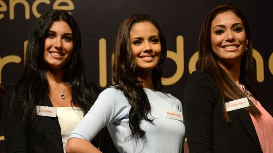 Miss Lebanon Karen Ghraoui, Miss Philippines Megan Young and Miss Puerto Rico Nadyalee Torres attend a news conference in Nusa Dua resort island of Bali on September 7, 2013. The final of the pageant will take place on the Hindu-majority holiday island of Bali instead of near the capital, after days of Muslim hardline protests.