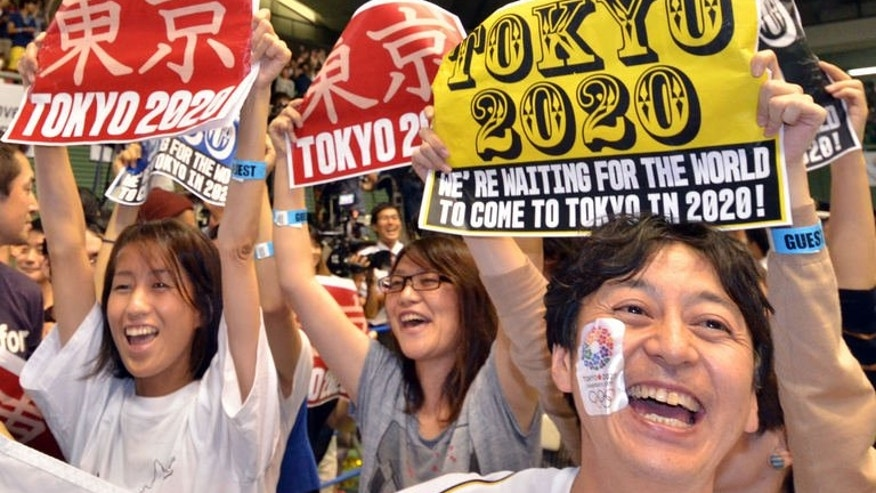 People celebrate as Tokyo wins the host city of the 2020 Olympics at the live-viewing event in Tokyo on September 8, 2013.