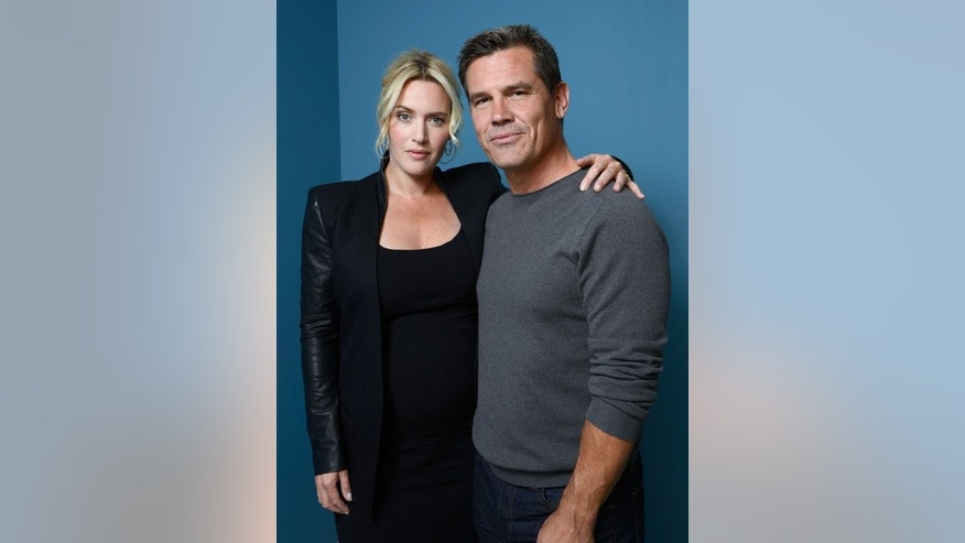 "Actress Kate Winslet (L) and actor Josh Brolin of ""Labor Day"" pose during 2013 Toronto International Film Festival on September 7, 2013 in Toronto, Canada."