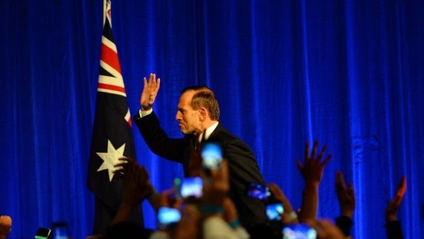 Australian Prime Minister-elect, Tony Abbott waves as he celebrates his victory in Sydney on September 7, 2013. Disunity within the Labor government helped conservative leader Abbott rise to power in Saturday's Australian elections, politicians and analysts said, with infighting and switching of leaders alienating voters.