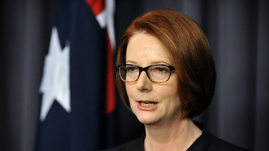 Australian Prime Minister Julia Gillard speaks to the media after her defeat in a party room vote to former prime minister Kevin Rudd, at Parliament House, Canberra on June 26, 2013. Disunity within the Labor government helped conservative leader Tony Abbott rise to power in Saturday's Australian elections, politicians and analysts said, with infighting and switching of leaders alienating voters.