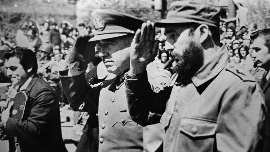 Picture dated 1971 showing General Augusto Pinochet (L), then Chile's army chief, saluting with Cuban leader Fidel Castro. September 11 is the 40th anniversary of the day in 1973 when air force planes bombed the presidential palace, toppling Salvador Allende, who committed suicide.