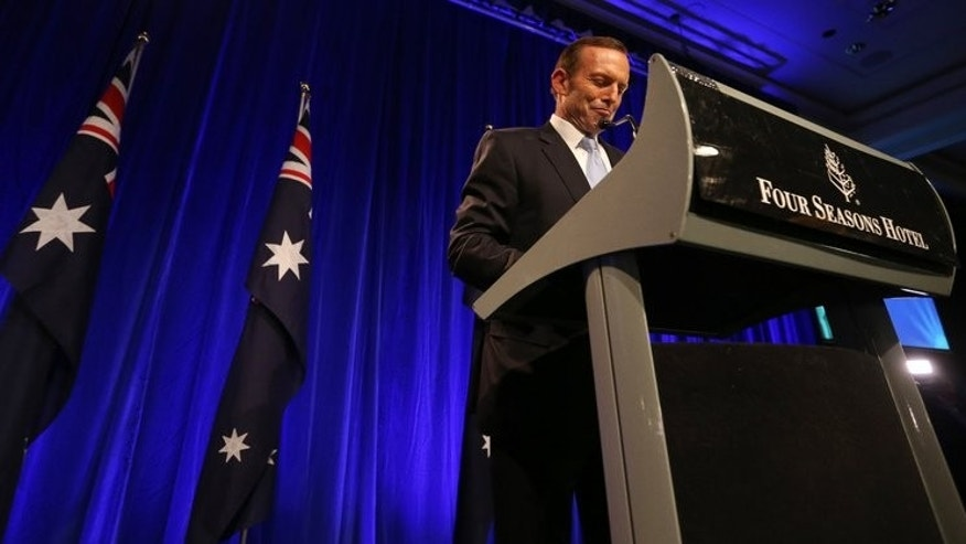 Australian Prime Minister-elect, Tony Abbott, prepares to make his victory speech on September 7, 2013. On Sunday he went out for an early morning bike ride as, describing it as 'just the start of another normal day'.
