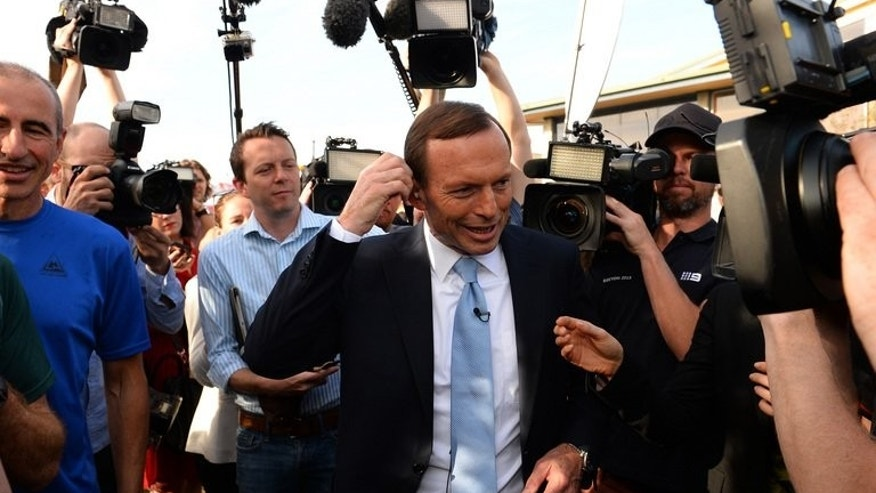 Tony Abbott prepares for an interview outside a polling station in Sydney on September 7, 2013. The prime minister-elect has vowed to push ahead with his agenda to stop asylum-seeker boats from arriving in Australia and to abolish the carbon tax.