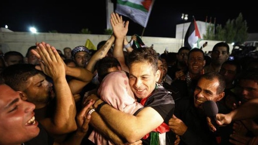 A freed Palestinian prisoner hugs a relative after his arrival in the West Bank city of Ramallah last month. (Reuters)