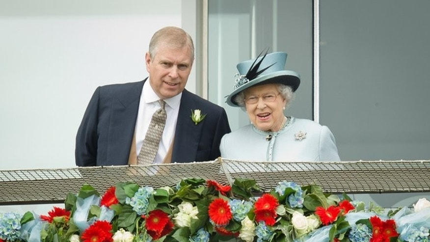 Prince Andrew, the Duke of York, speaks to Queen Elizabeth II at the Epsom Derby Festival in England on June 1, 2013. Prince Andrew was challenged by jittery royal protection officers in the gardens of Buckingham Palace last week as they stepped up security following a break-in, police admitted on Sunday.