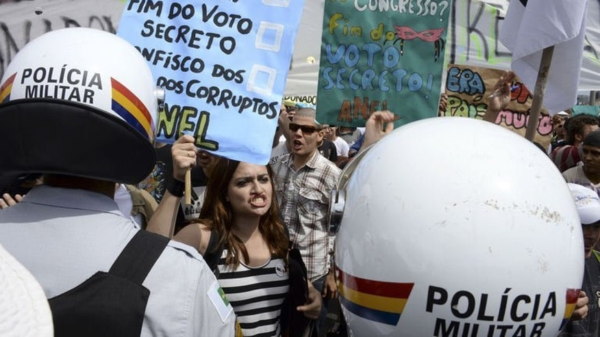 People take part in a protest in front of the congress building in Brasilia on September 7, 2013. Protesters in Brazil tried to regain the energy of June's massive street protests with rallies planned in more than 100 cities on Saturday, the country's independence day -- but efforts fizzled with low turnout.