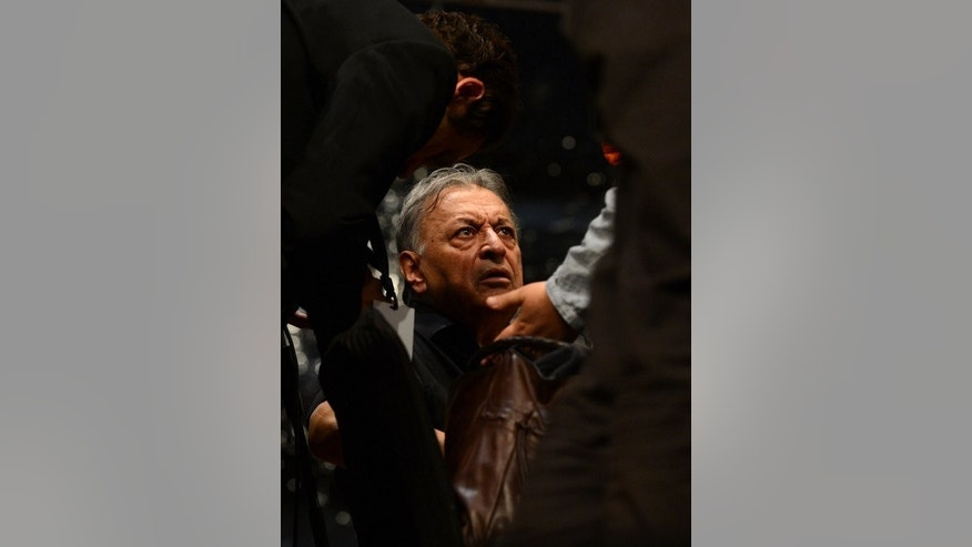 Indian conductor Zubin Mehta seen here during a rehearsal for the upcoming Ehaas-Kashmir music concert in Srinagar on September 6, 2013. Indian troops have stepped up security in Srinagar, ahead of a concert to be held later in the day by Mehta.