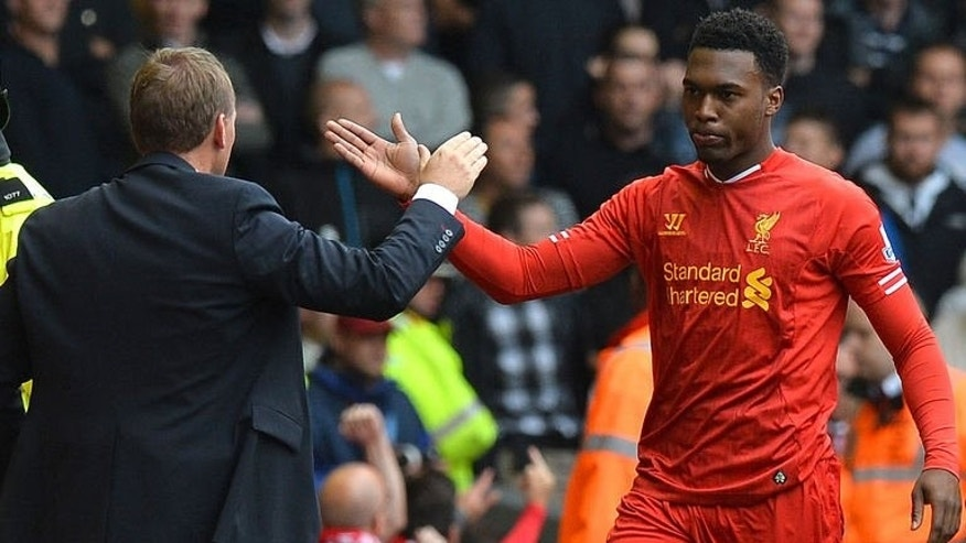 Liverpool's striker Daniel Sturridge (R) celebrates with Liverpool's manager Brendan Rodgers at the Anfield stadium in Liverpool, northwest England, on September 1, 2013. Sturridge has been ruled out of his side's crucial World Cup qualifier against Ukraine on Tuesday, the Football Association (FA) said Saturday.