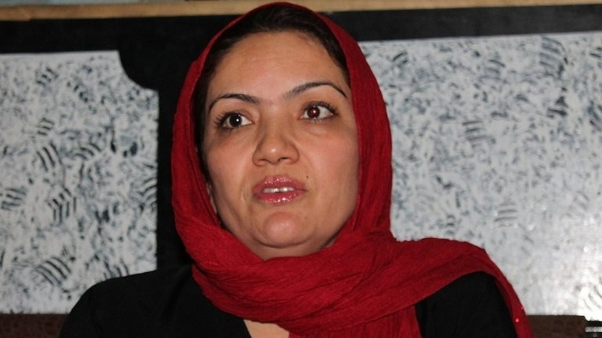 This photograph taken on June 9, 2013 shows Afghan lawmaker Fariba Ahmadi Kakar speaking during an interview with AFP in Kandahar. The Taliban claims that Kakar -- an Afghan female MP held hostage by the militant group since August 10 -- has been freed in exchange for six prisoners who were relatives of their fighters.