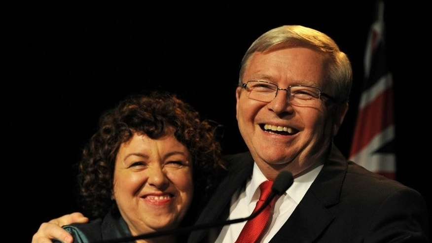 Australian Prime Minister Kevin Rudd hugs his wife Therese after conceding election defeat on September 7, 2013. Tony Abbott said Rudd called him and accepted defeat graciously following the poll results.