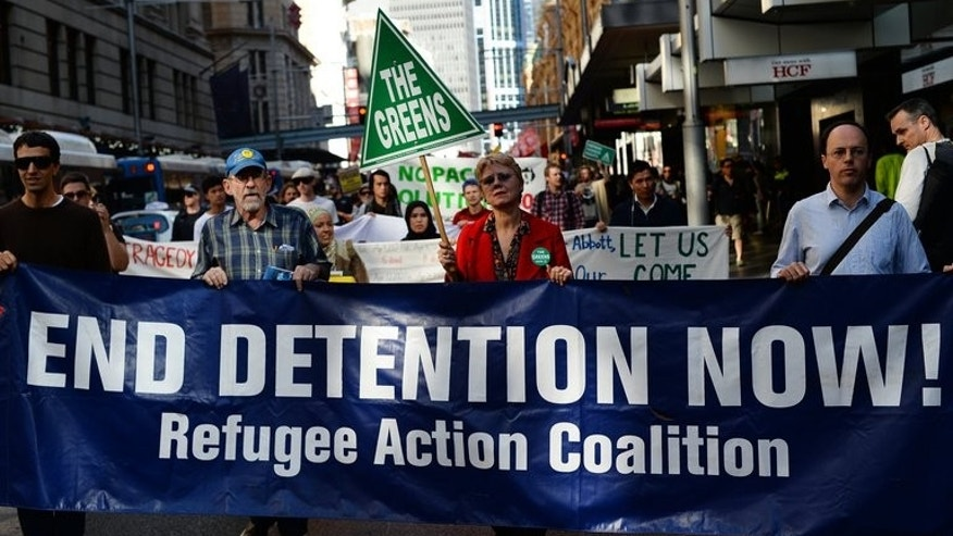 Demonstrators rally against the Australian government's asylum seeker policy in Sydney on August 24, 2013. The first people-smuggling boat to arrive under Tony Abbott's watch arrived Monday.