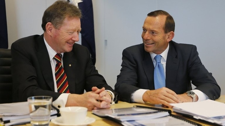 Australia's conservative leader and prime minister-elect Tony Abbott (R) on September 8, 2013. Abbott put a pledge to 'Stop the boats' at the centre of his election campaign.