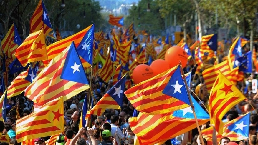 Image taken on September 11, 2012 shows supporters of independence for Catalonia demonstrating in Barcelona. Hundreds of thousands of Catalans will unite to create a 400-km human chain on September 11, part of a spectacular campaign for independence fiercely opposed by Madrid.