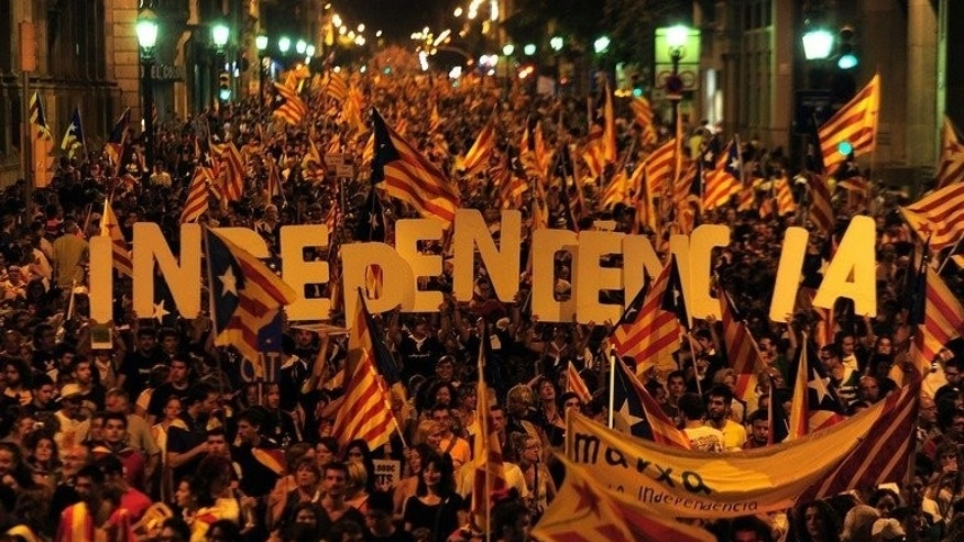 Image taken on September 11, 2012 shows supporters of independence for Catalonia demonstrating in Barcelona. Some 400,000 people aim to join hands along the entire coastline of the northeastern region of Catalonia on the same day this year to demand an historic redrawing of the map of Spain.