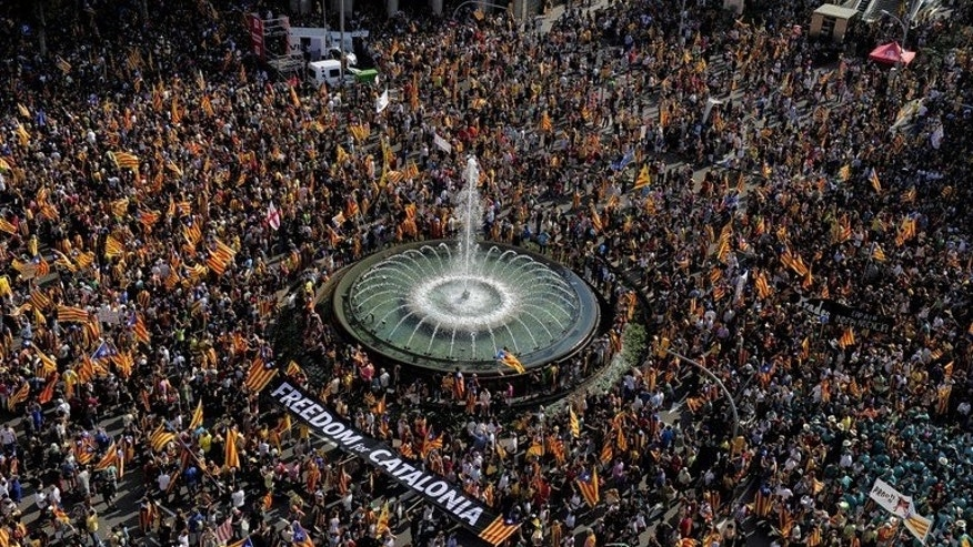 Image taken on September 11, 2012 shows supporters of independence for Catalonia demonstrating in Barcelona. The protest is organised by Catalan separatists on the region's national day, which recalls the final defeat of Catalan troops by Spanish King Philip V's forces in 1714.