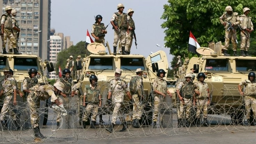 Egyptian army soldiers block a highway to prevent supporters of the Muslim Brotherhood from crossing during their demonstration in Cairo, on July 19, 2013. The deadly crackdown on Islamists across Egypt could radicalise their ranks and at the same time further bolster the powerful army during the country's transitional phase, experts say.