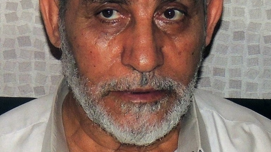 Muslim Brotherhood leader Mohamed Badie shortly after his arrest in Cairo, on August 20, 2013. Egypt's state prosecutor has said Badie will stand trial in a second case over clashes in which several demonstrators were killed, according to judicial sources.